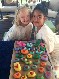 Cassia Price, right, and Mia Hattaway display their painted rocks. [Courtesy of Naomi Hattaway]