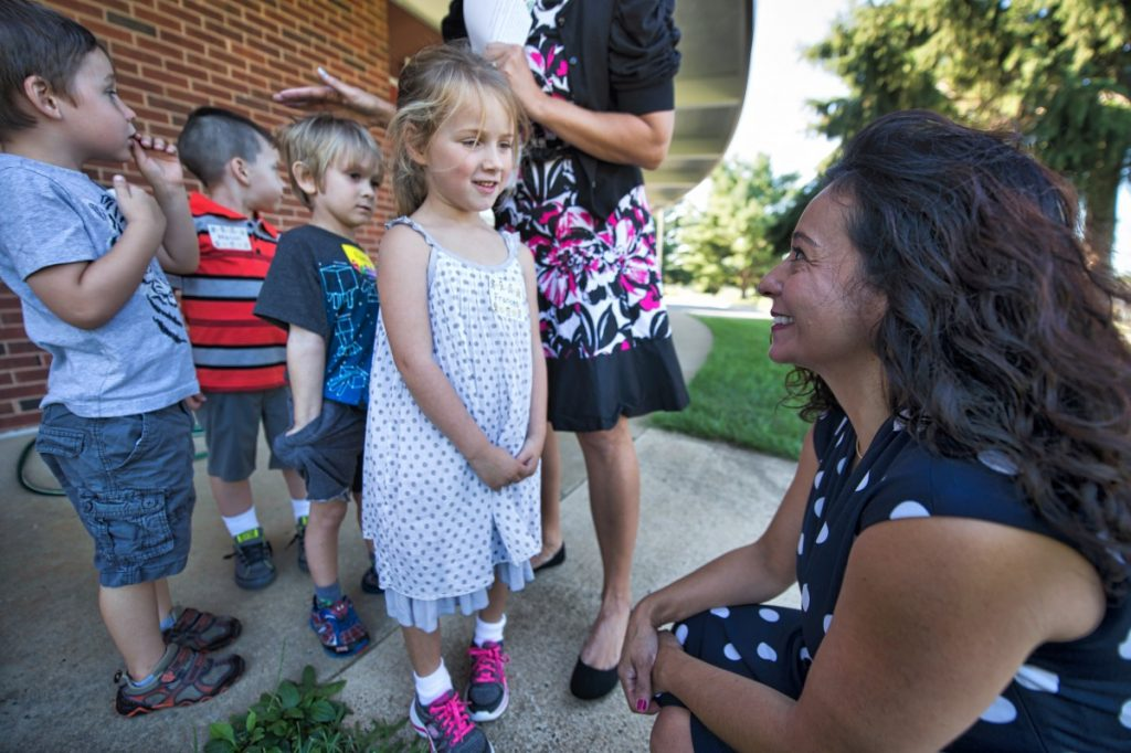 Hillsboro Charter Academy Principal Trisha Ybarra-Peters greets kindergarteners during orientation Monday. [Douglas Graham/Loudoun Now]