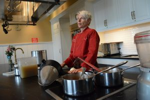 Chef Bonnie Moore teaches in a classroom kitchen at Willowsford. [Renss Greene/Loudoun Now]