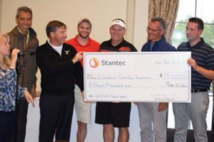School Board member Jeff Morse (Dulles) accepts a $15,000 check from architect firm Stantec, the title sponsor of the Loudoun Education Foundation's Golf Classic. [Loudoun Education Foundation]