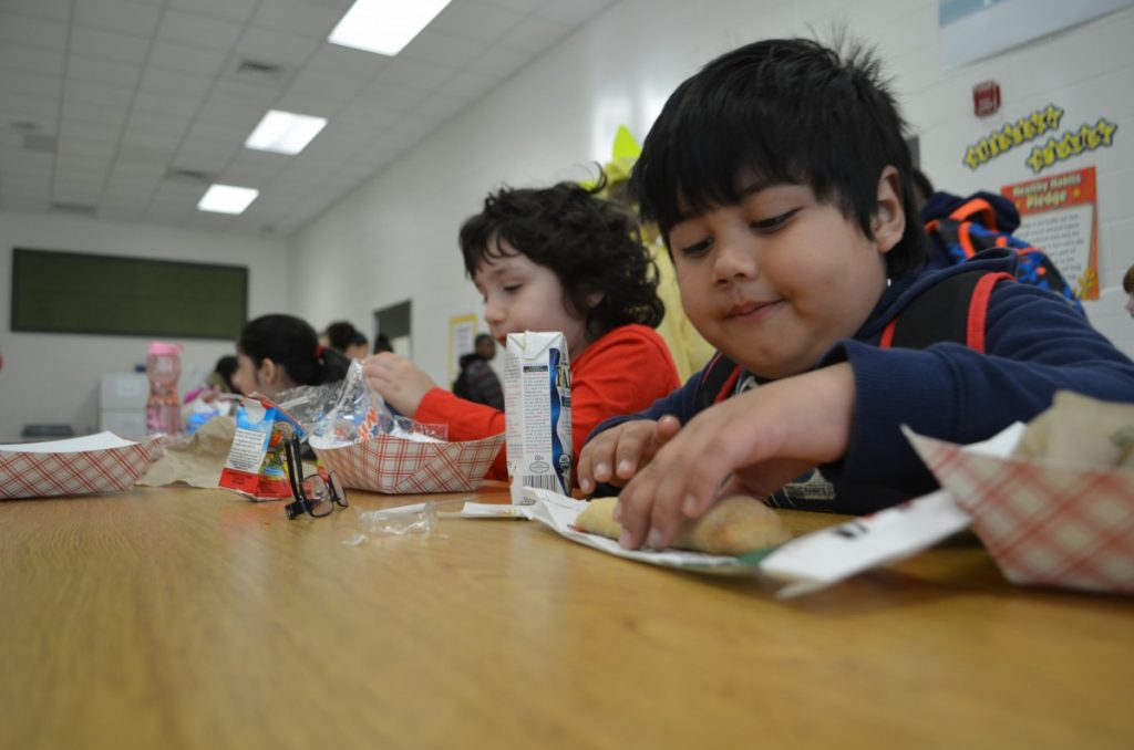 Students at Frederick Douglass Elementary School in Leesburg enjoy breakfast. In their effort to keep up with the growing number of students with allergies, Loudoun's schools introduced signs that let students know whether dishes contain any of the most common allergens. [Loudoun Now/Danielle Nadler]
