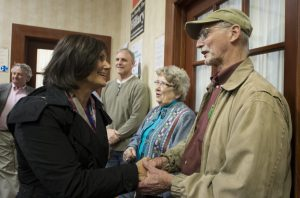 Congressional candidate LuAnn Bennett (D) greets people at the Democratic Headquarters in downtown Winchester. (Douglas Graham/Loudoun Now)