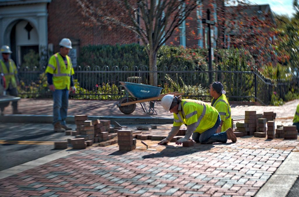 Workers are putting together the final pieces of the Rt. 50 Traffic Calming Project, which includes new curbs, gutters, crosswalks and sidewalks in downtown Middleburg. [Douglas Graham/Loudoun Now]
