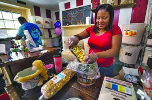 Mickey and Deltone Moore pack fresh orders in their new location in downtown Middleburg.  [Douglas Graham/Loudoun Now]