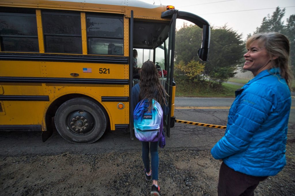 Shea Ill, 14 of Taylorstown, boards a bus after saying bye to her mom, Tami Ill (Douglas Graham/Loudoun Now)