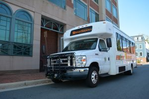 A Loudoun County Transit bus picks up riders at the county government building in Leesburg. (Renss Greene/Loudoun Now)