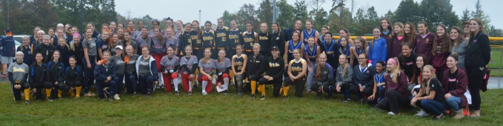 Softball teams—people who Madison has played with—gather for a group picture. (Renss Greene/Loudoun Now)