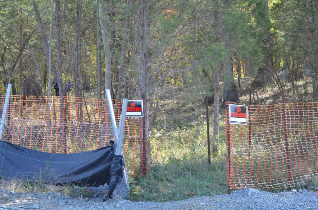 Signs meant to deter trespassers from entering the cemetery site were posted last week. [Danielle Nadler/Loudoun Now]