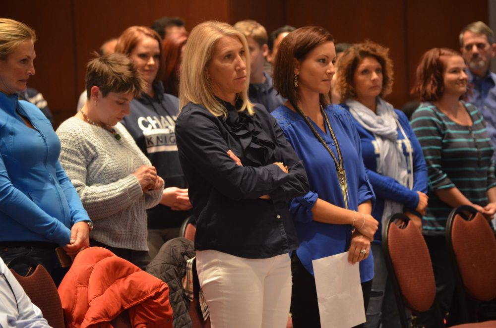 Parents in the audience stood to show support for most speakers during the public hearing on boundaries Monday. [Danielle Nadler/Loudoun Now]