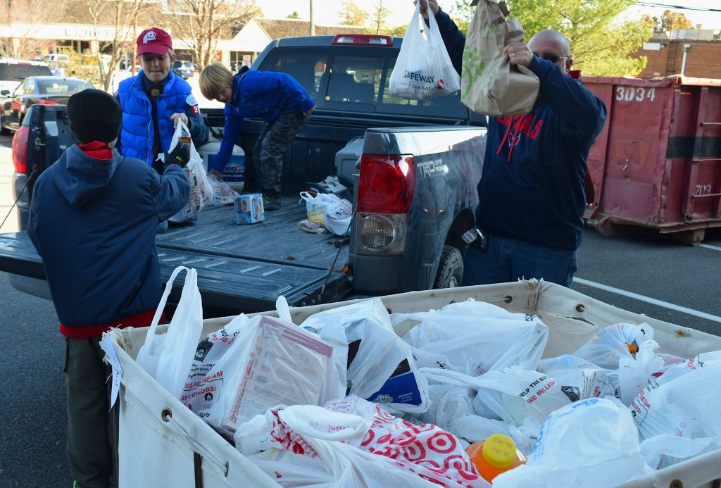 Scouts and adult leaders unload a truckload of donations at the Loudoun Hunger Relief collection site in Leesburg.