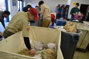 After a weigh-in, scouts begin sorting donations at the Loudoun Hunger Relief collection site in Leesburg.