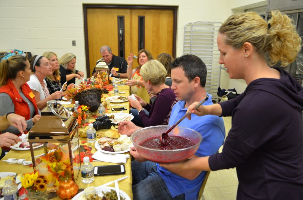 Parent volunteers sit down for their meal at Providence Academy's Thanksgiving Feast. [Danielle Nadler/Loudoun Now]