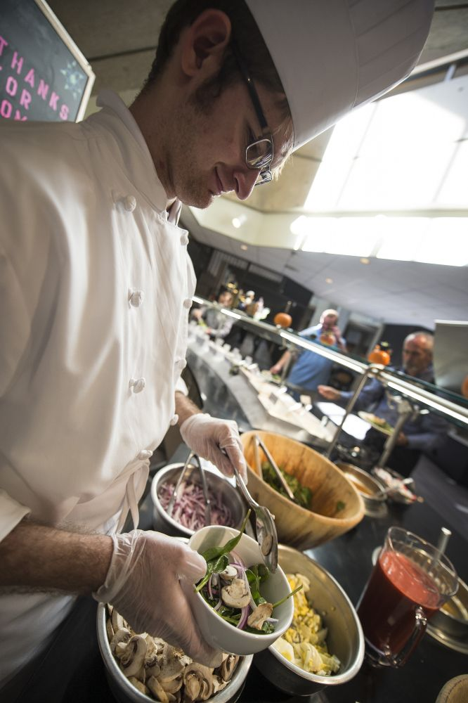 Project SEARCH intern Matias Vorimo makes salads at National Conference Center. [Douglas Graham/Loudoun Now]