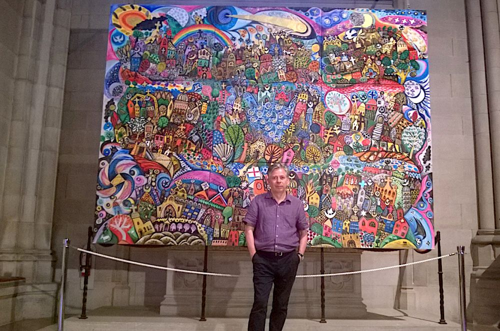 Brian Whelan's painting on exhibit at the Washington National Cathedral depicts Christian churches, Islamic mosques and Jewish synagogues existing in harmony. [Submitted photo]