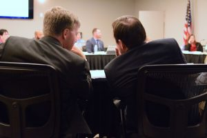 Dulles school board member Jeff Morse and Supervisor Matthew F. Letourneau (R) confer. (Renss Greene/Loudoun Now)
