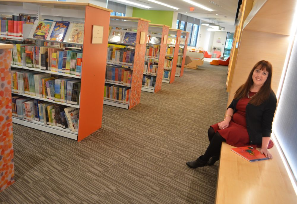 Christine Thompson, manager of the Brambleton Library, sits in the  library's children's section. [Danielle Nadler/Loudoun Now]. The teen center  ...